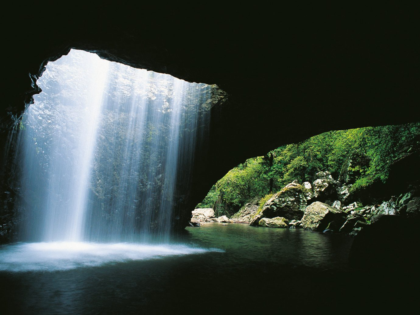 Offbeat Nature Waterfall water body of water atmospheric phenomenon water feature light night reflection