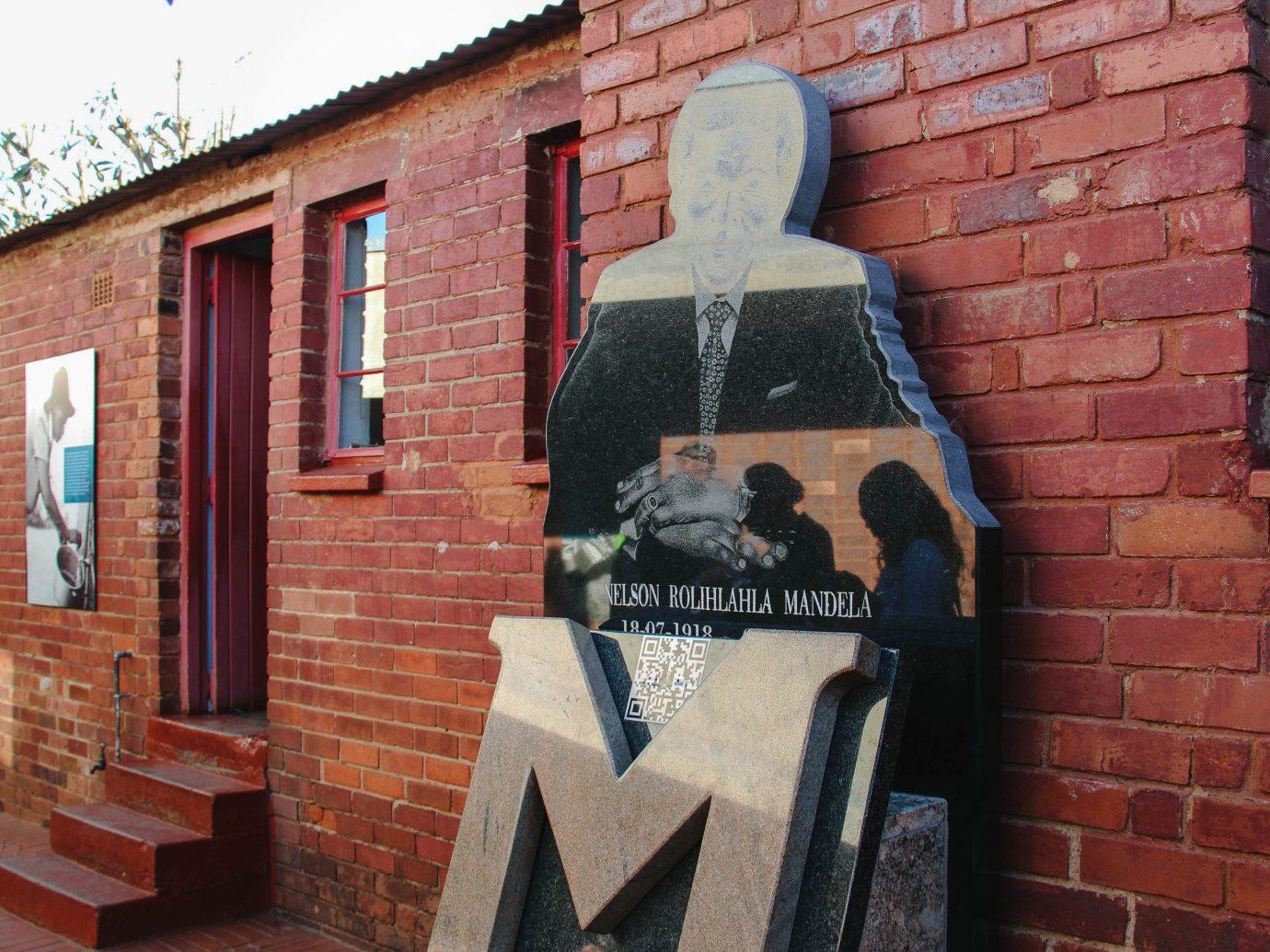 Arts + Culture Trip Ideas brick building outdoor wall house mural street art brickwork facade window