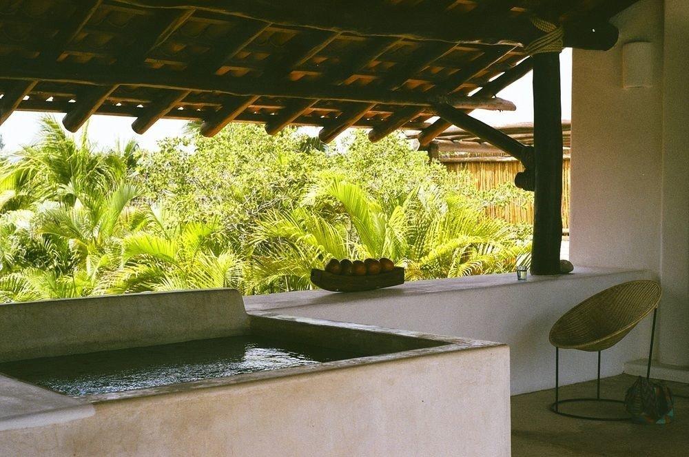 Boutique Hotels Hotels Mexico Tulum green building interior design estate restaurant Design flower