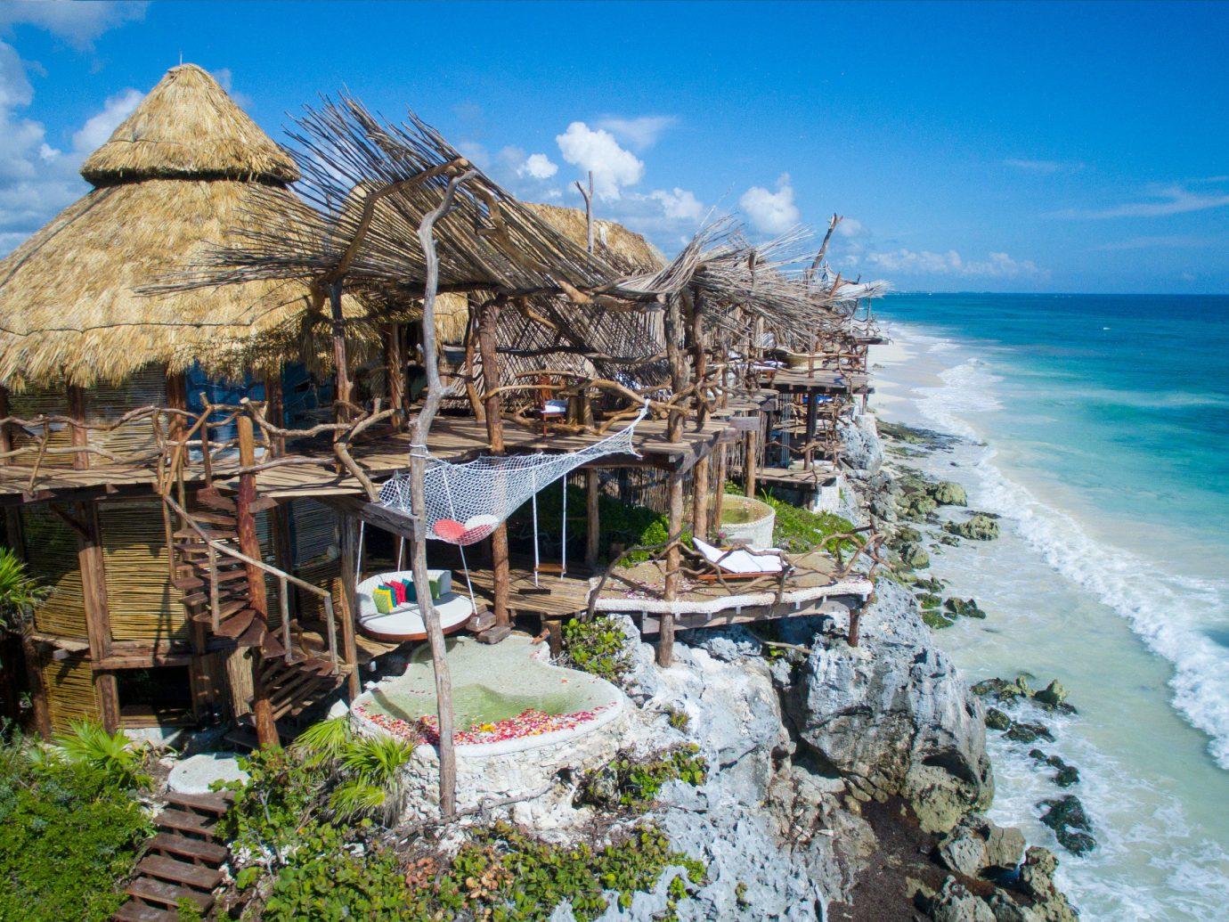 Trip Ideas outdoor sky water Nature vacation Coast Sea tourism Resort Beach hut Village lawn Island
