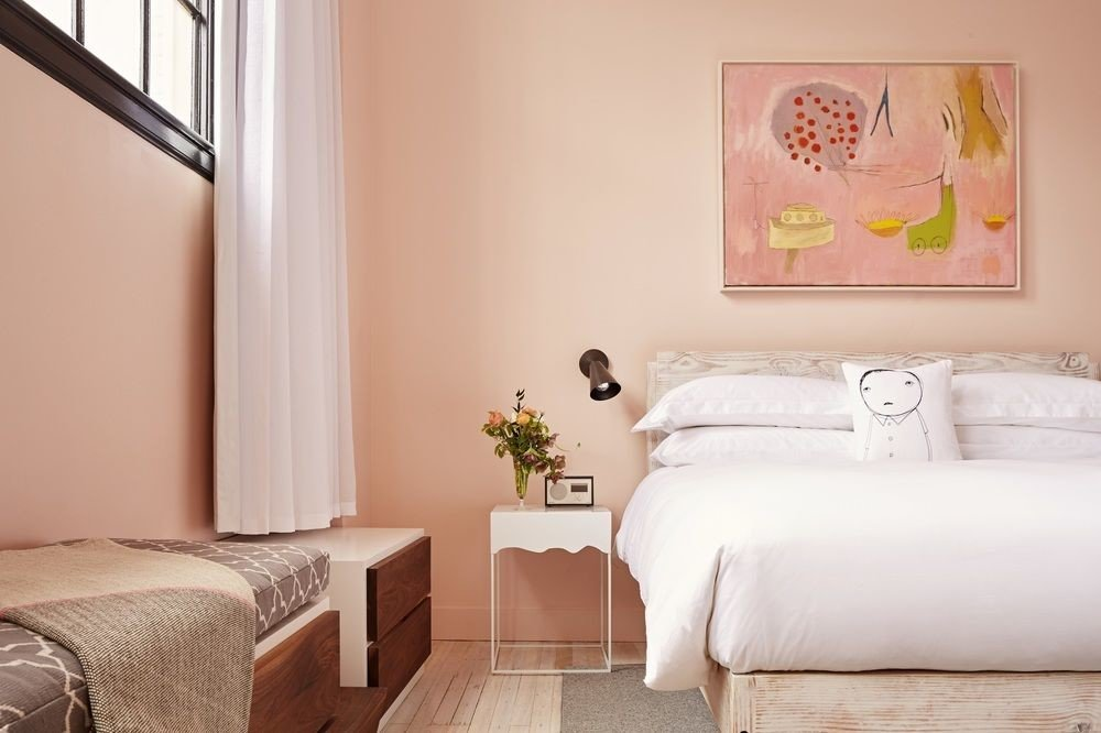 Hotels wall indoor sofa room property bed Bedroom interior design floor home Suite cottage pillow real estate apartment living room decorated painting