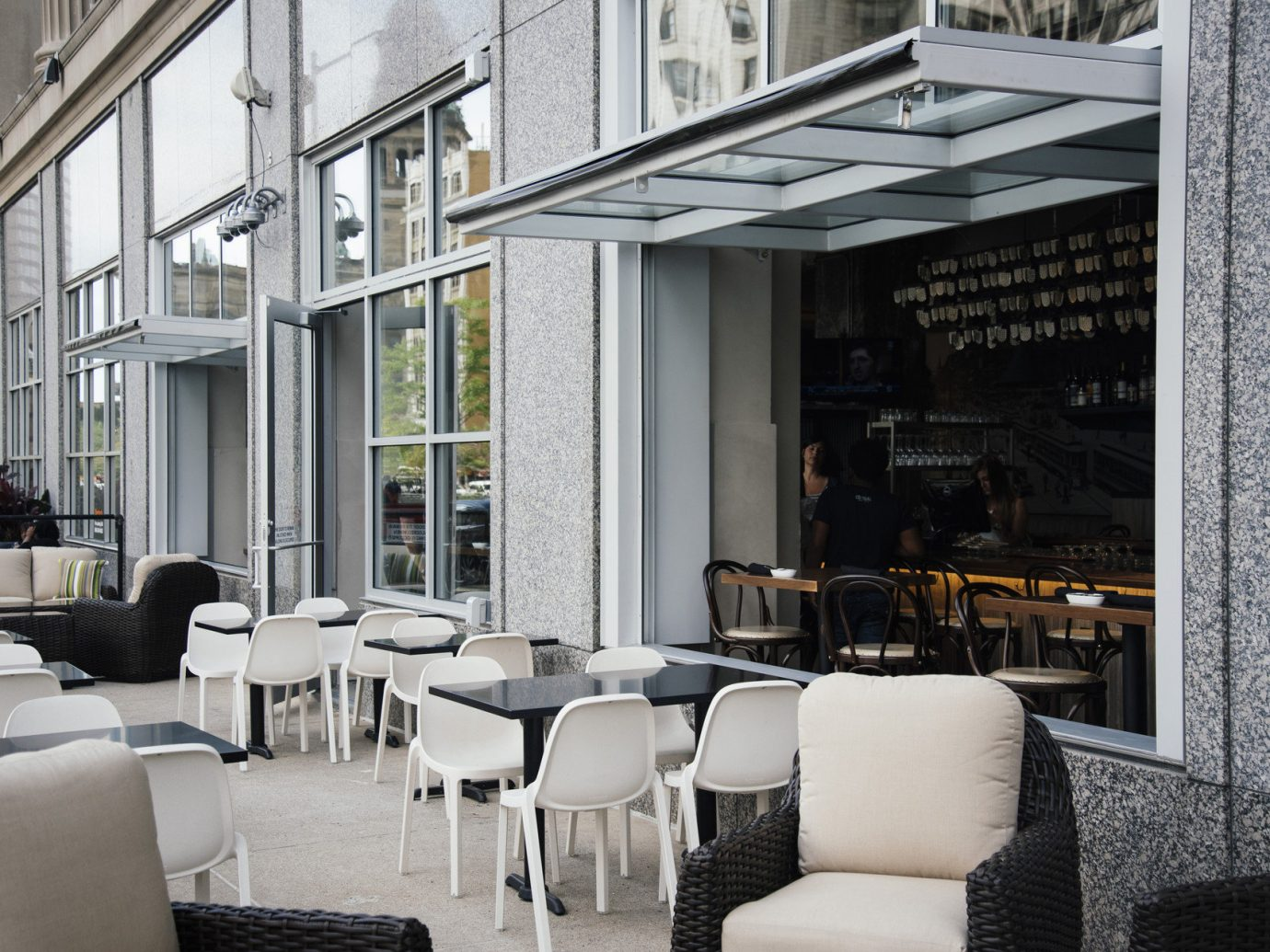 City Dining Exterior Food + Drink Hip outdoor dining outdoor lounge Patio restaurant tables Terrace trendy room chair indoor Living Architecture interior design home furniture living room Design condominium Lobby window covering hotel area decorated