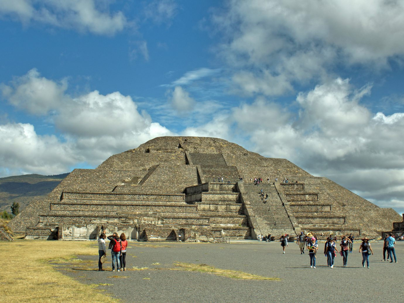 Arts + Culture Mexico City Travel Tips Trip Ideas sky historic site landmark cloud archaeological site ancient history monument tourist attraction pyramid maya civilization tourism unesco world heritage site wonders of the world badlands mountain travel plateau rock
