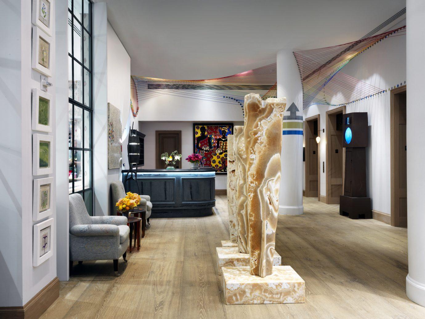 Hotels NYC indoor floor room property Living Boutique home living room interior design estate Lobby hall retail Design flooring furniture