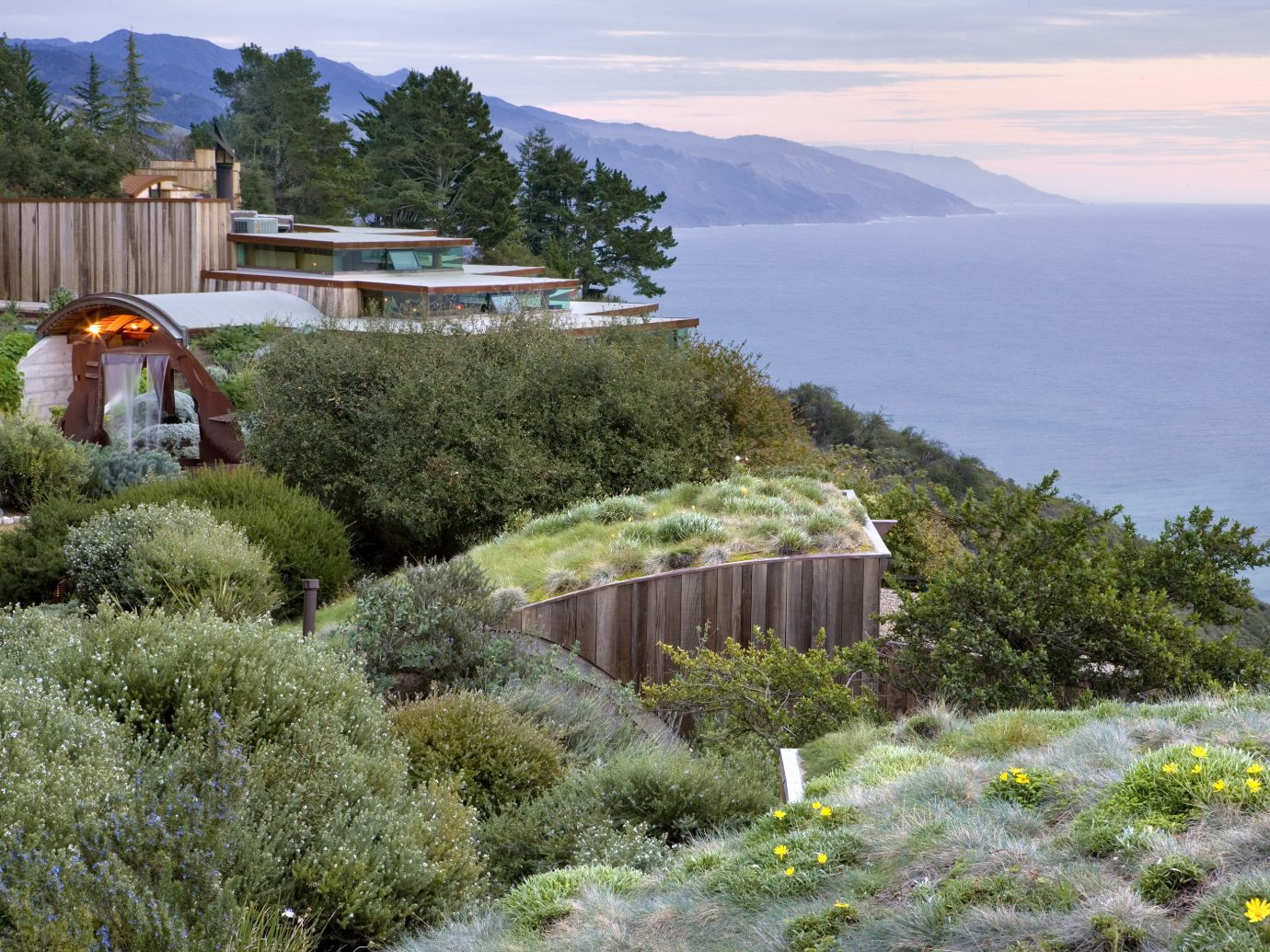 Hotels outdoor grass sky tree vacation plant estate landscape Coast Garden flower hillside