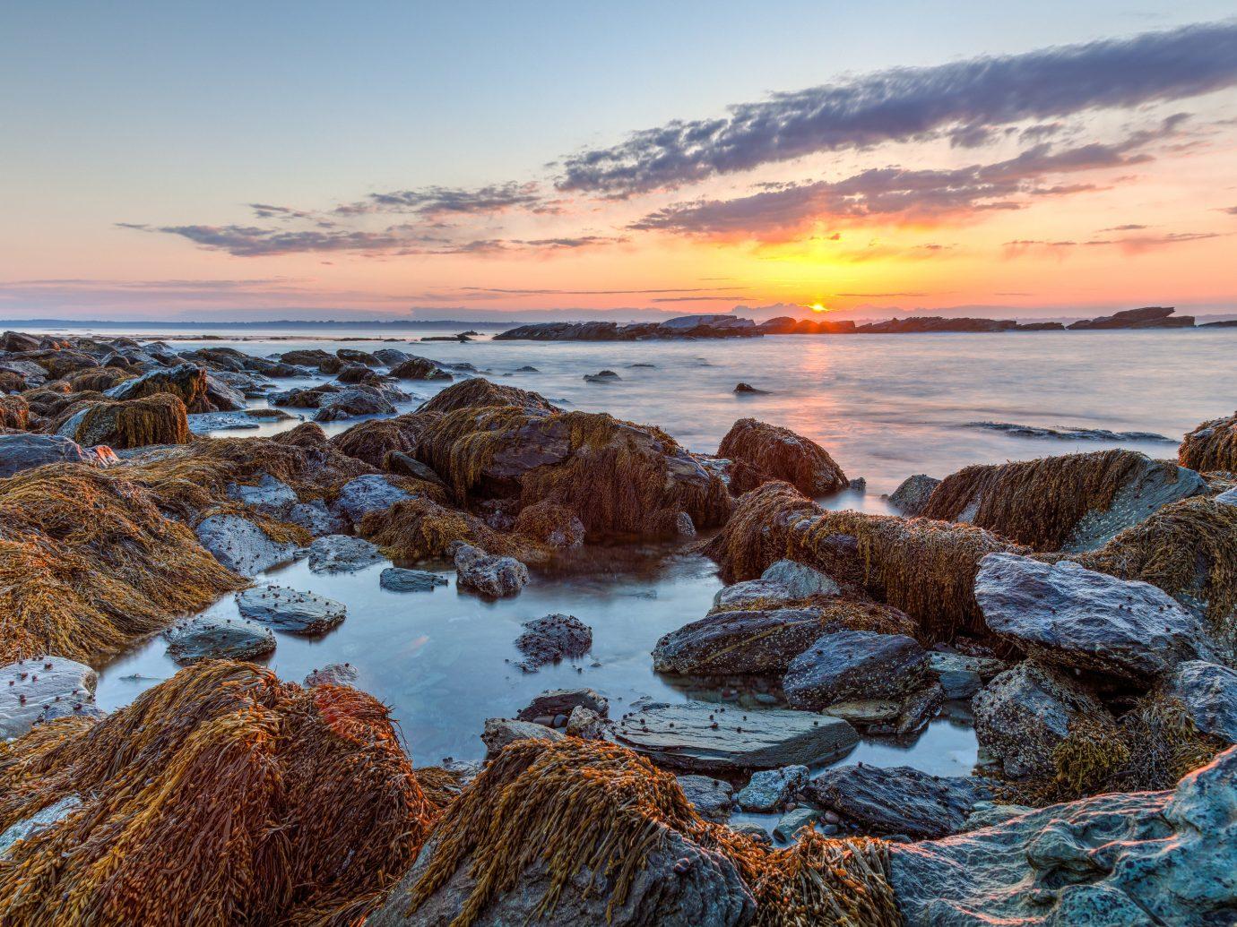 outdoor sky shore Coast Sea Ocean body of water rock sunrise Beach Nature Sunset horizon wave cloud wind wave morning dawn rocky landscape evening dusk bay material sand cape