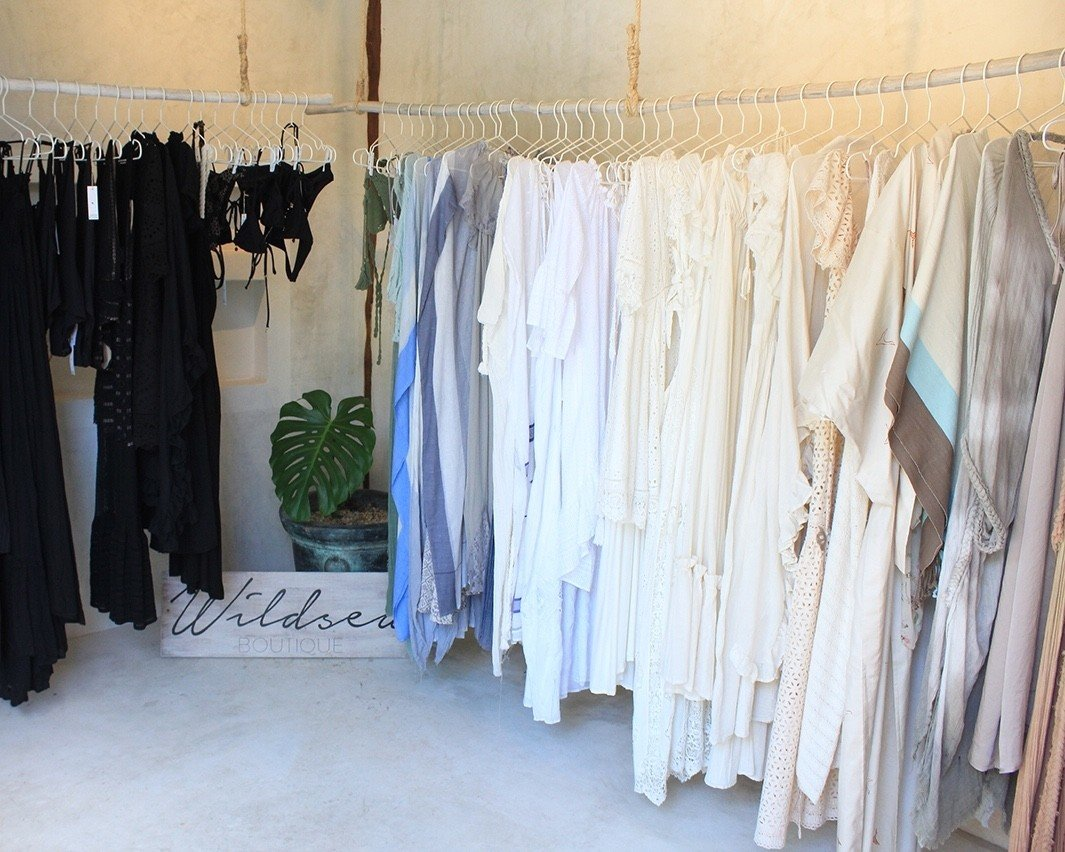 City Mexico Trip Ideas Tulum furniture Boutique room curtain clothes hanger dress interior design textile gown window wood window treatment floor flooring closet