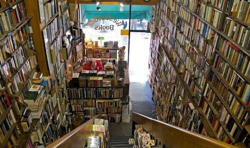 Arts + Culture book shelf library scene room bookselling indoor building retail aisle inventory grocery store full supermarket store Shop