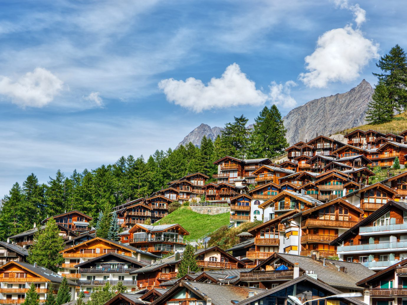 alpine skiing Lakes + Rivers Mountains + Skiing Outdoors + Adventure Trip Ideas sky outdoor mountain village mountainous landforms mountain mountain range tree Village scene hill station cloud rural area City landscape alps plant mount scenery hill tourism roof house elevation several