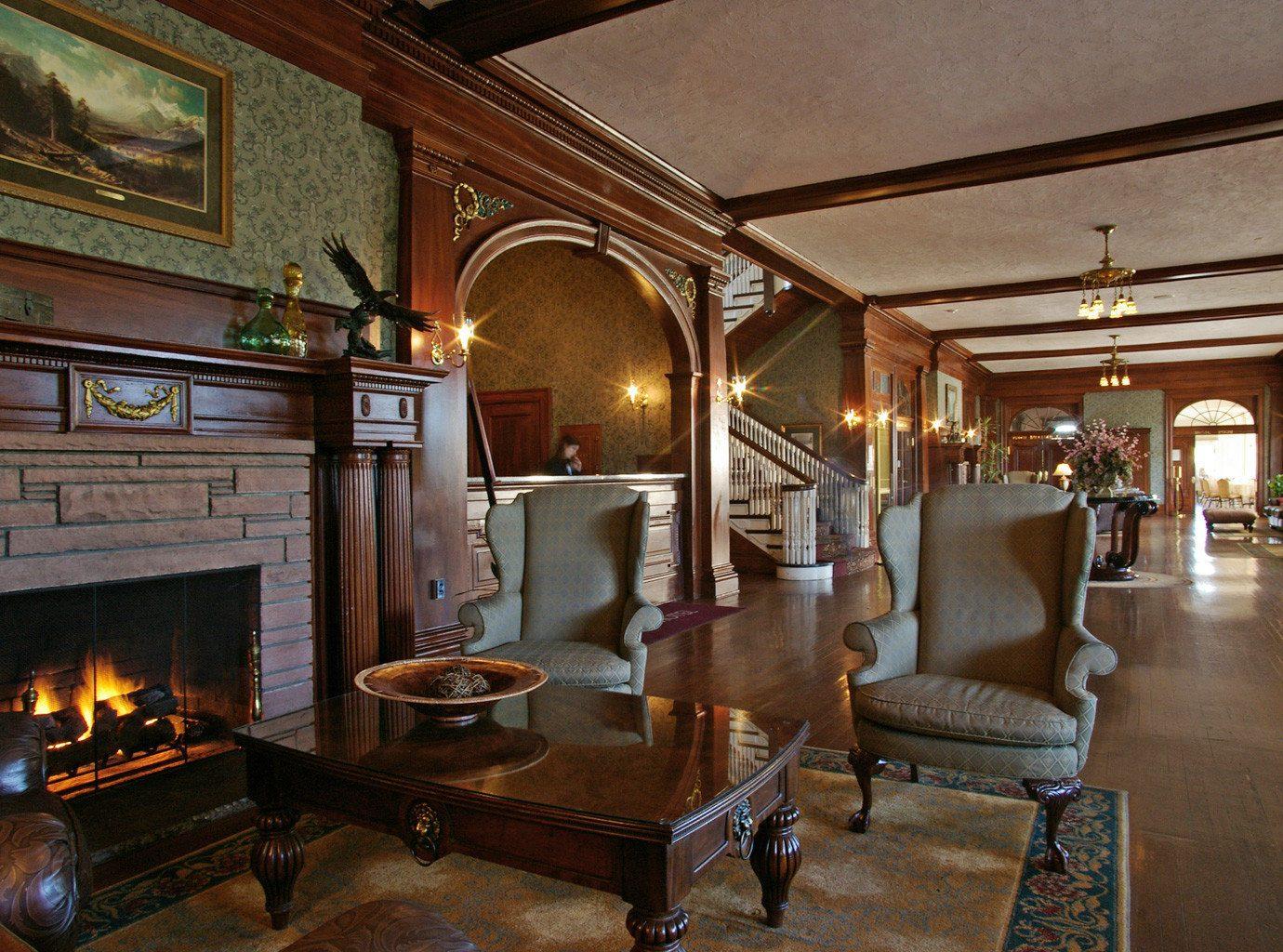 Fireplace Historic Hotels Lounge Resort indoor room floor Living property estate building Lobby home living room interior design lighting mansion restaurant furniture