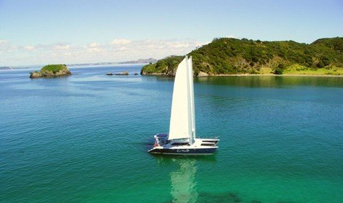 Trip Ideas water sky outdoor Boat Lake vehicle bay sailing vessel watercraft Lagoon sailboat green Sea inlet floating shore Island traveling surrounded