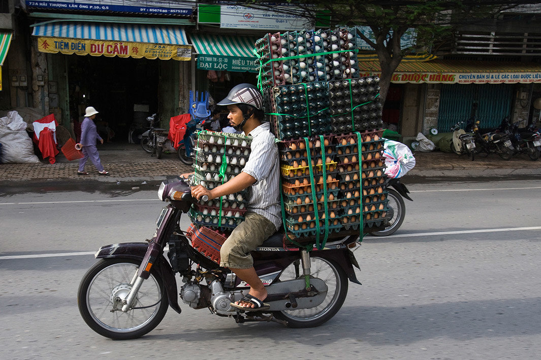 Arts + Culture outdoor road street riding person vehicle bicycle rickshaw motorcycle infrastructure travel