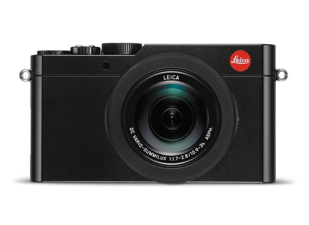 Packing Tips Style + Design Travel Shop electronics digital camera cameras & optics camera camera lens product mirrorless interchangeable lens camera product design camera accessory