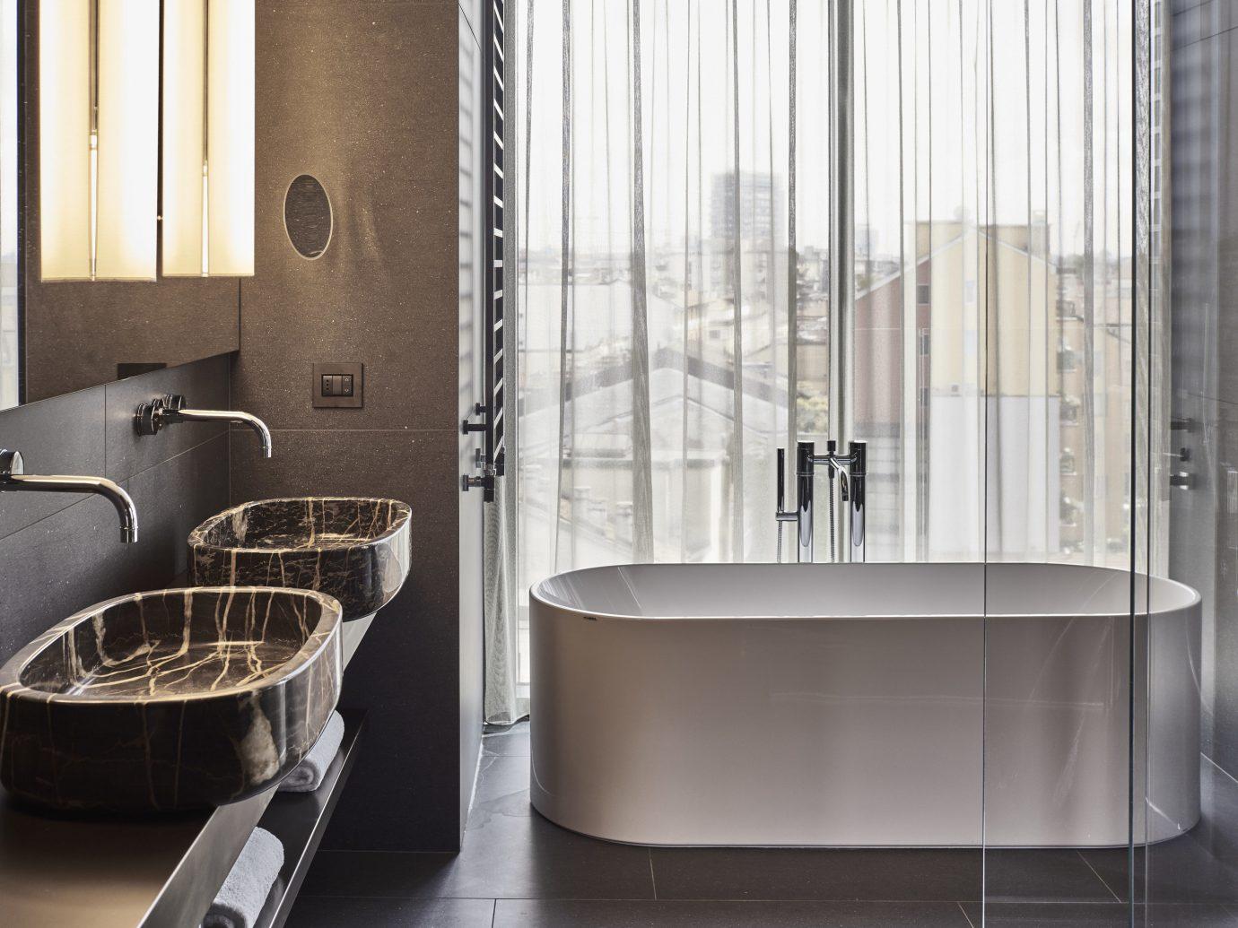 Hotels Italy Milan indoor bathroom room window interior design tap plumbing fixture sink product design floor tile flooring angle interior designer product
