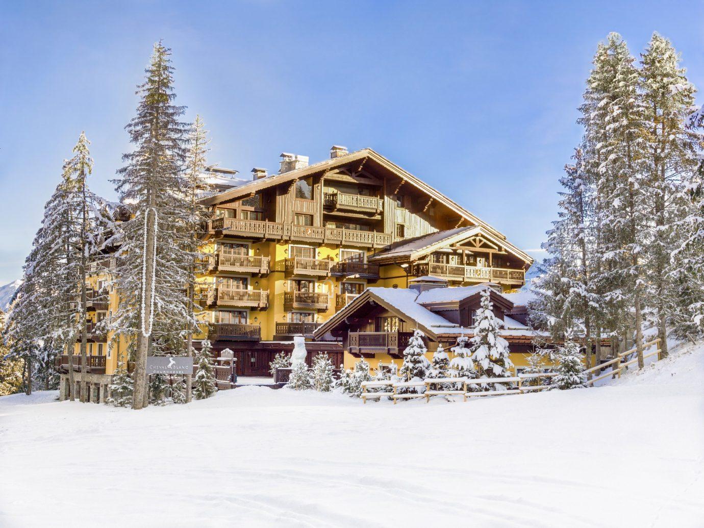 Hotels Luxury Travel Mountains + Skiing outdoor snow sky tree Winter piste geological phenomenon Resort season log cabin ride