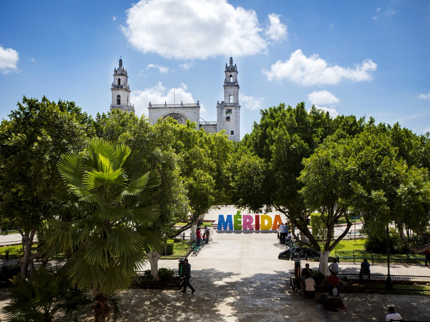 Mexico Trip Ideas Weekend Getaways tree sky outdoor City landmark Town neighbourhood urban area human settlement tourism vacation plaza town square cityscape Downtown park flower plant day
