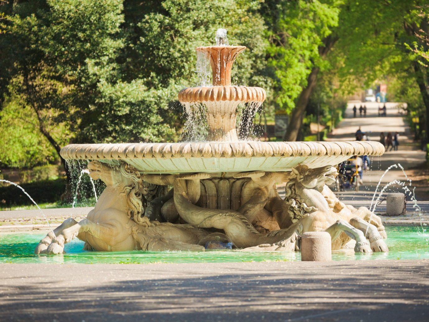 Outdoors + Adventure tree outdoor fountain water feature sculpture Garden carving