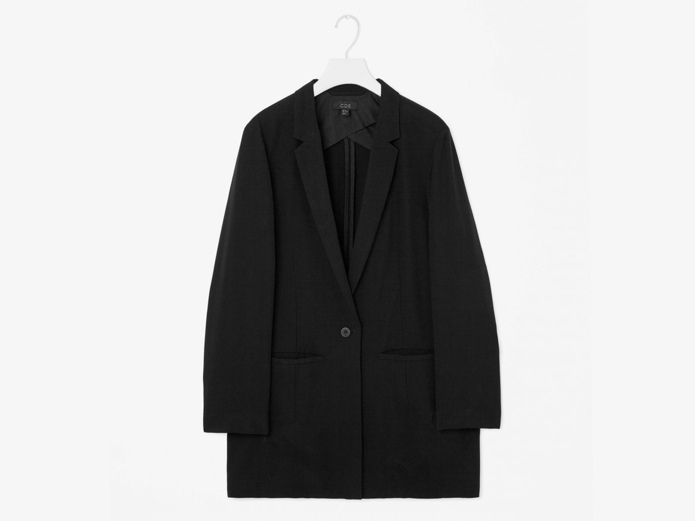 Style + Design clothing suit man coat outerwear overcoat sleeve formal wear wool jacket tuxedo collar pocket posing tan