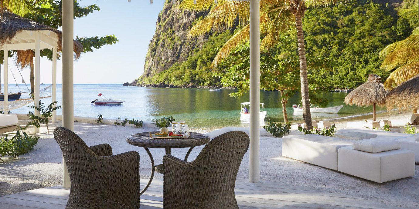 Hotels Luxury Travel Trip Ideas tree property outdoor Villa swimming pool vacation estate backyard outdoor structure interior design furniture Resort porch Patio