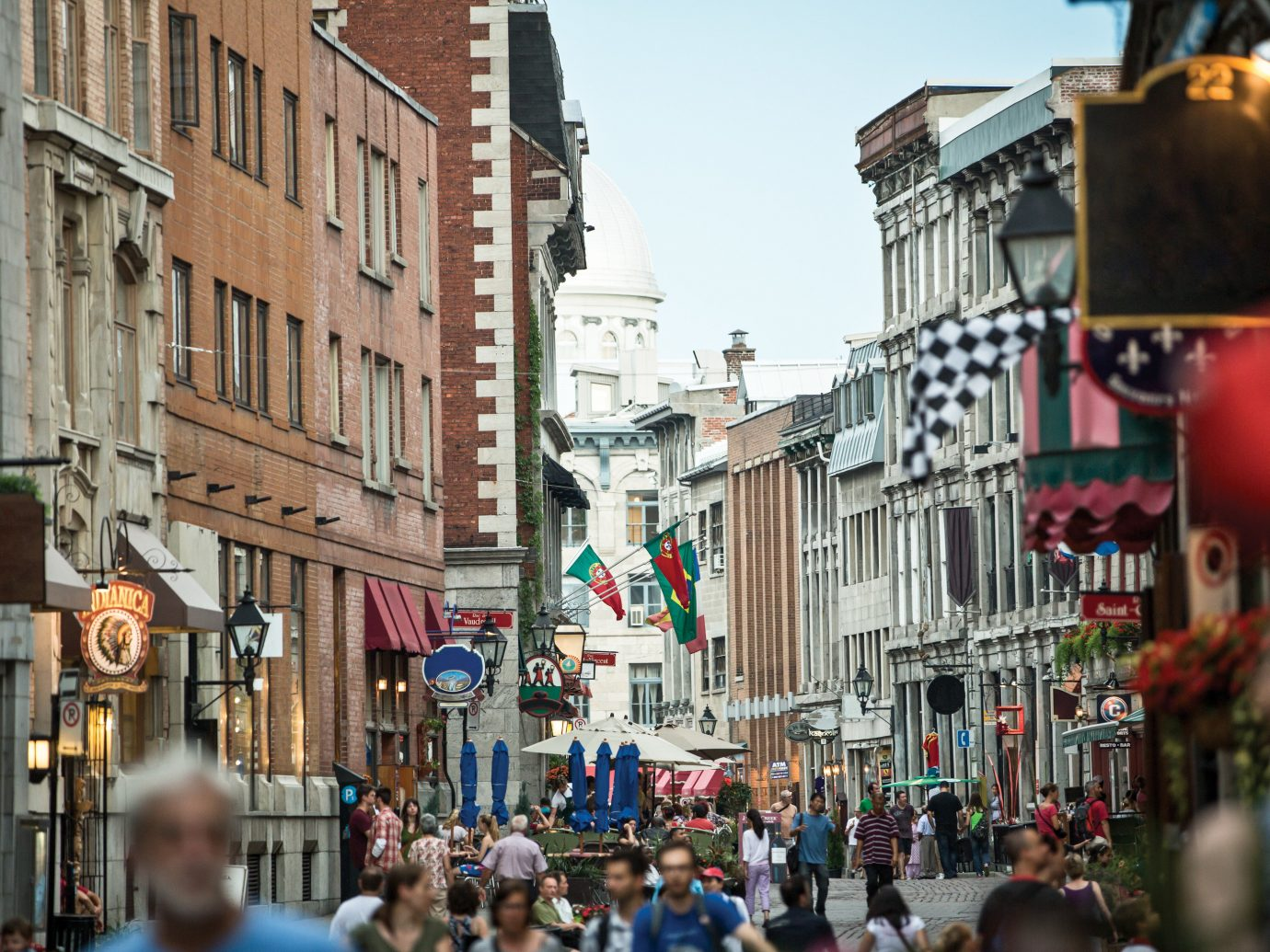 People on a busy shopping street in Montreal, Canada