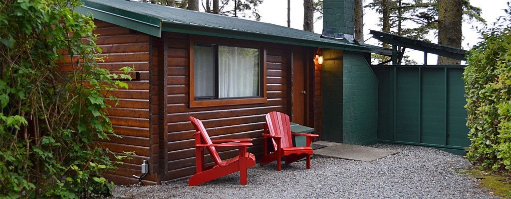 Boutique Hotels Fall Travel Hotels Outdoors + Adventure outdoor tree ground red shed house home cottage siding backyard shack garden buildings log cabin real estate yard facade outdoor structure hut outhouse stone