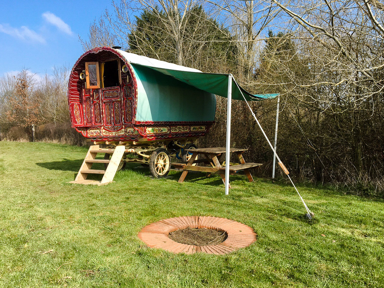 Glamping Outdoors + Adventure Trip Ideas outdoor grass tree sky plant rural area hut house green meadow tent landscape old lawn shed outdoor object