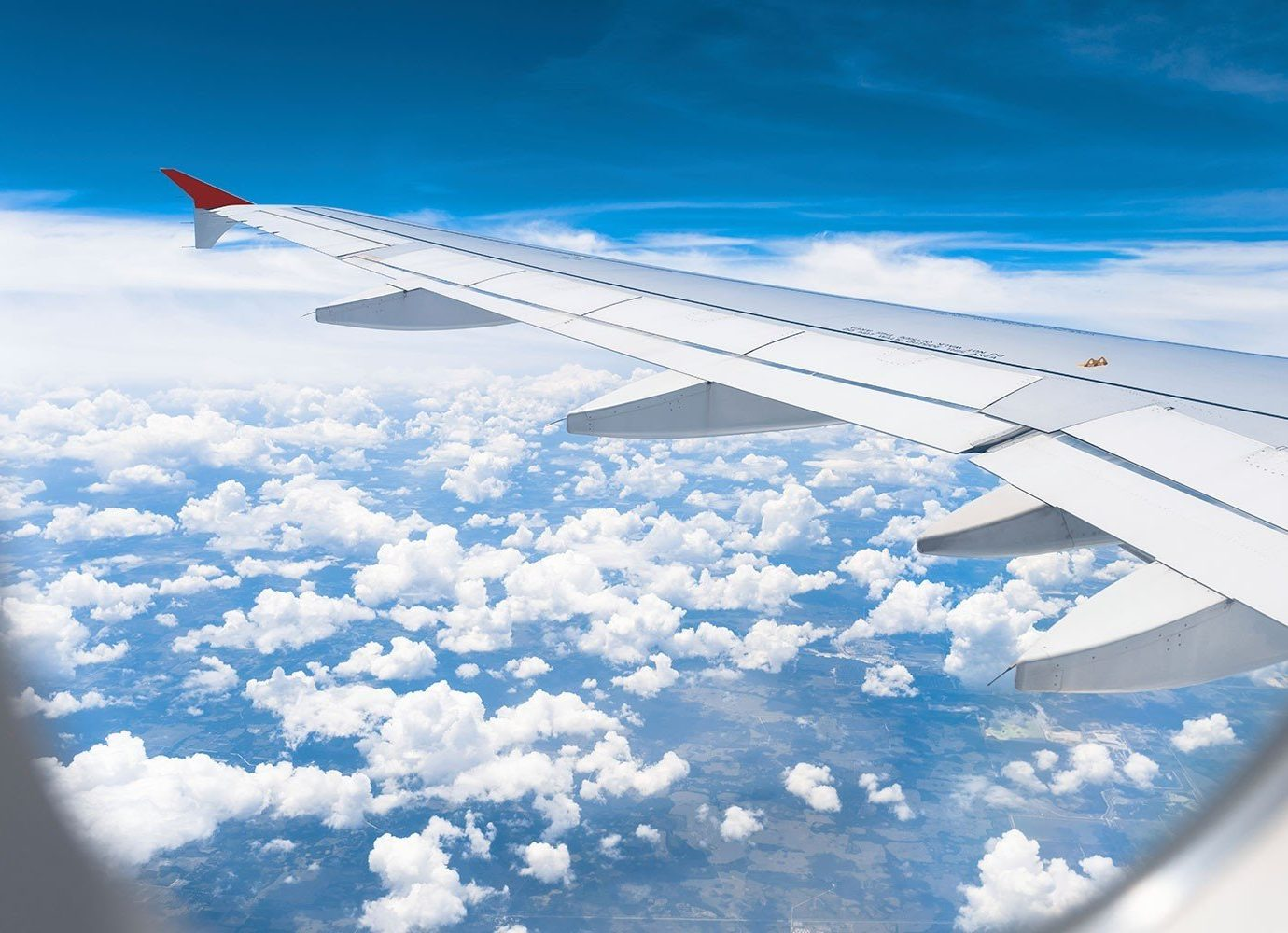 Offbeat sky outdoor plane airline airplane air travel blue aircraft airliner atmosphere clouds atmosphere of earth cloud flight Nature vehicle aviation wing jet narrow body aircraft day