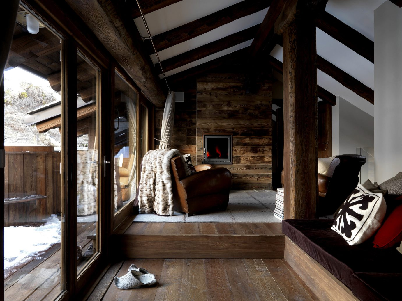 Hotels Luxury Travel Mountains + Skiing Trip Ideas indoor Living building window house room home Architecture estate interior design wood living room Design mansion floor cottage stone furniture