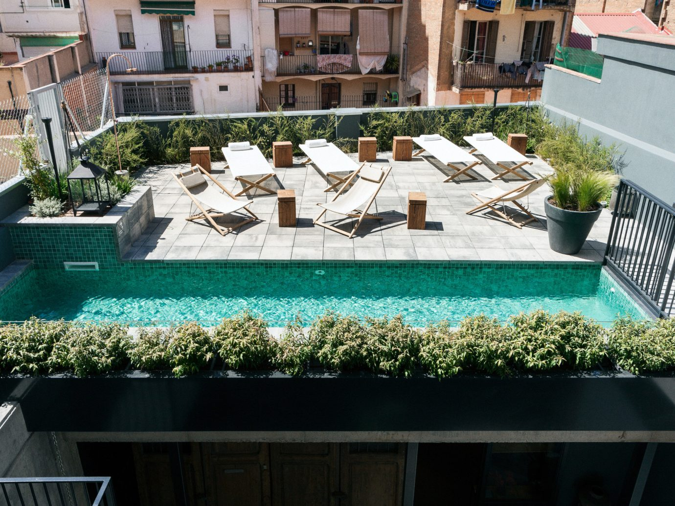 Barcelona Hotels Spain property outdoor swimming pool Courtyard condominium real estate outdoor structure house roof backyard apartment leisure landscaping amenity
