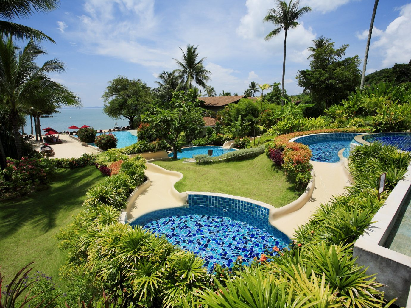 Beach Hotels Phuket Thailand Nature Resort swimming pool leisure property estate majorelle blue palm tree arecales tropics real estate water tourism resort town tree vacation sky landscape Villa caribbean plant landscaping amenity