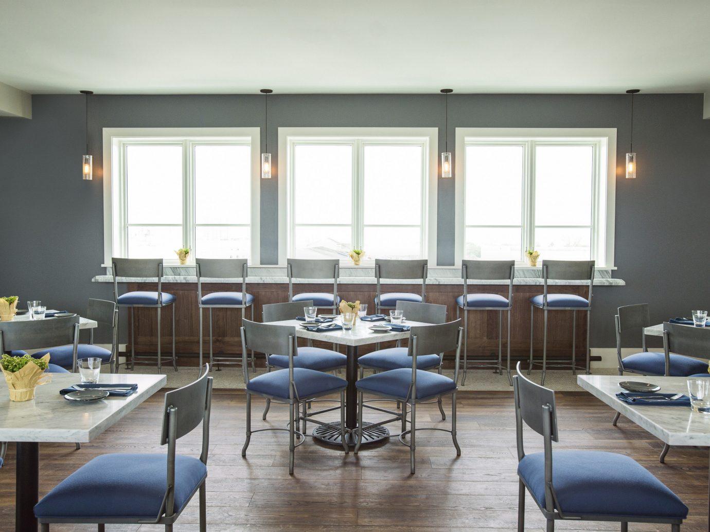 Hotels floor table indoor chair window ceiling room interior design furniture restaurant classroom dining room area several