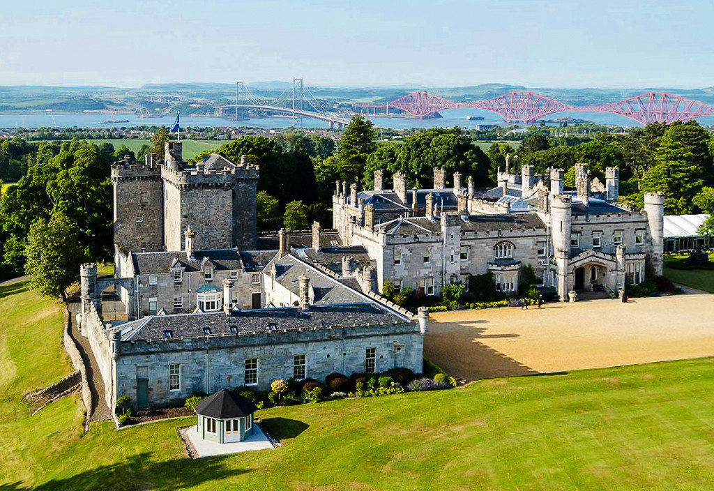 Glamping Outdoors + Adventure Trip Ideas grass outdoor building château stately home castle estate sky mansion national trust for places of historic interest or natural beauty tree palace medieval architecture City
