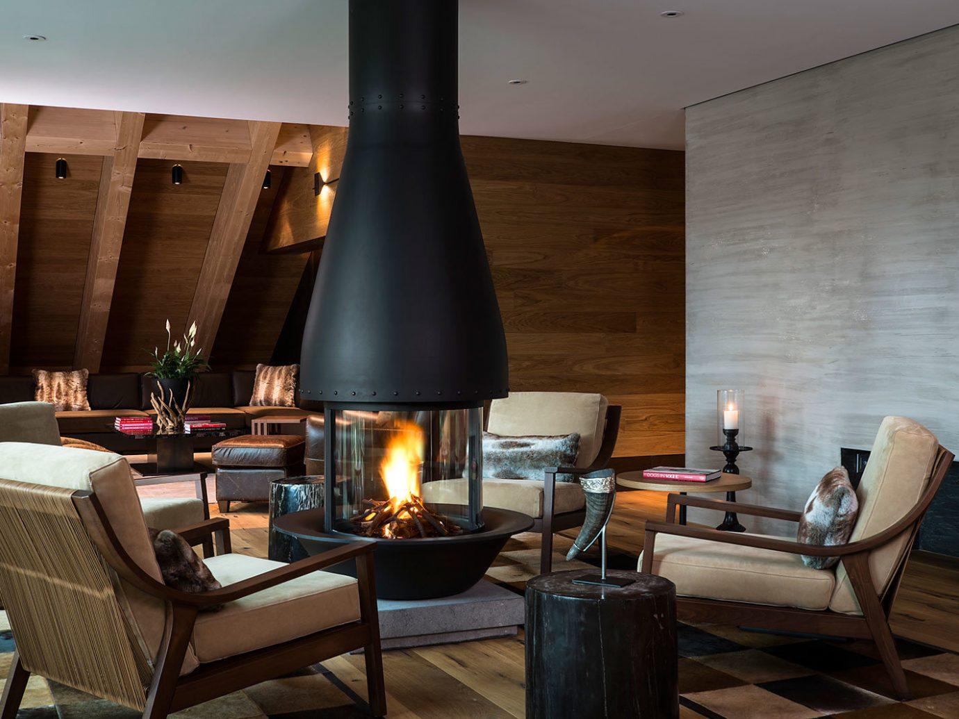 Hotels indoor room floor Living property living room hearth interior design lighting wood home estate Design cottage furniture