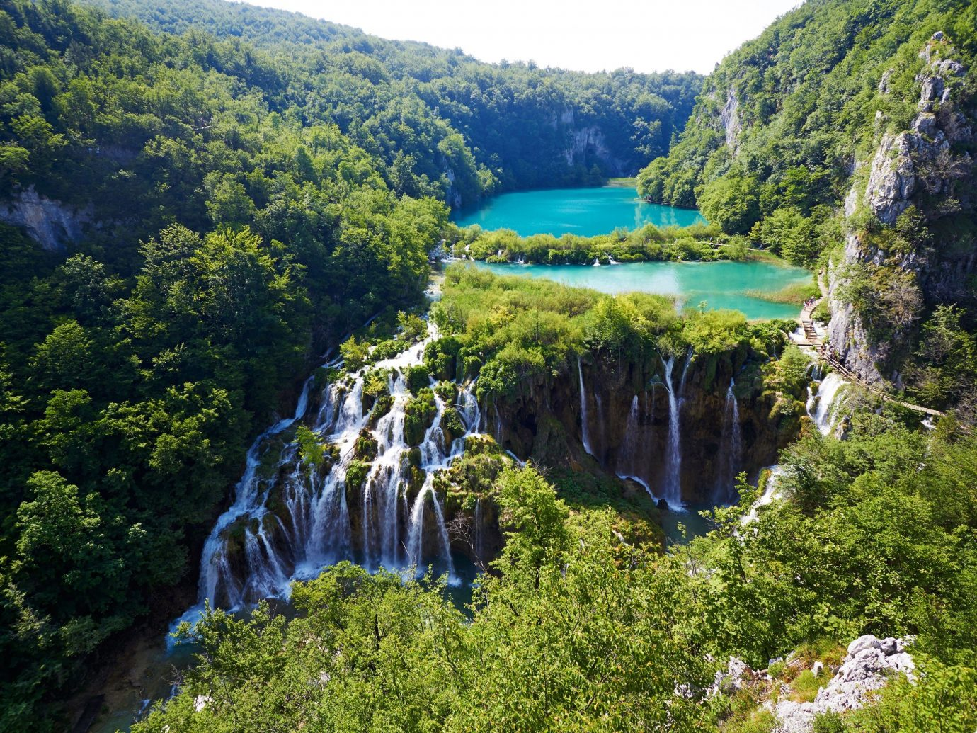 Jetsetter Guides tree outdoor mountain nature reserve Waterfall Nature body of water River water feature Forest park fjord Lake rainforest national park reservoir hillside wooded surrounded lush