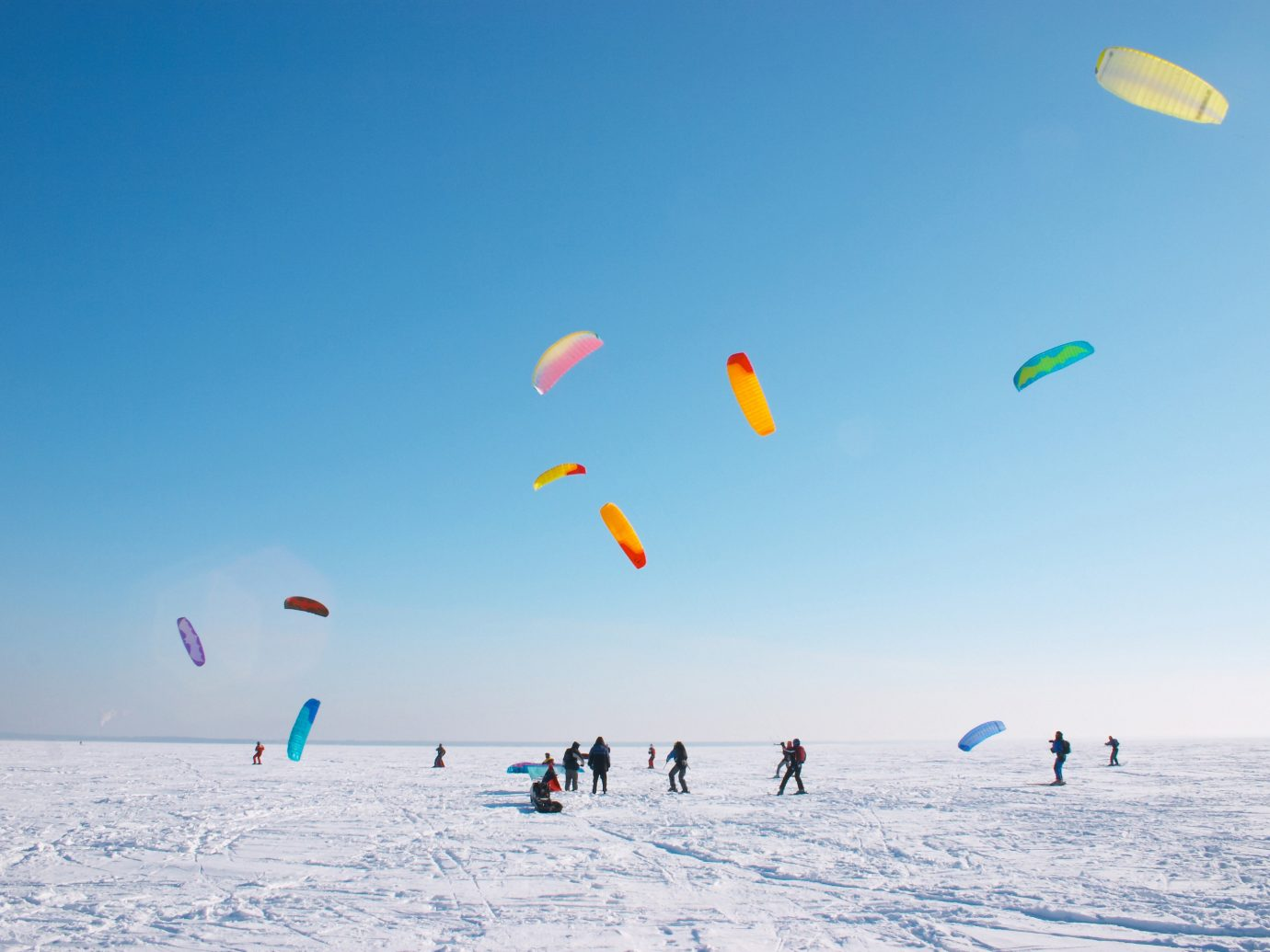 Offbeat sky sports outdoor windsports people toy atmosphere of earth kite sports extreme sport snowkiting kitesurfing wind surfing equipment and supplies several colored