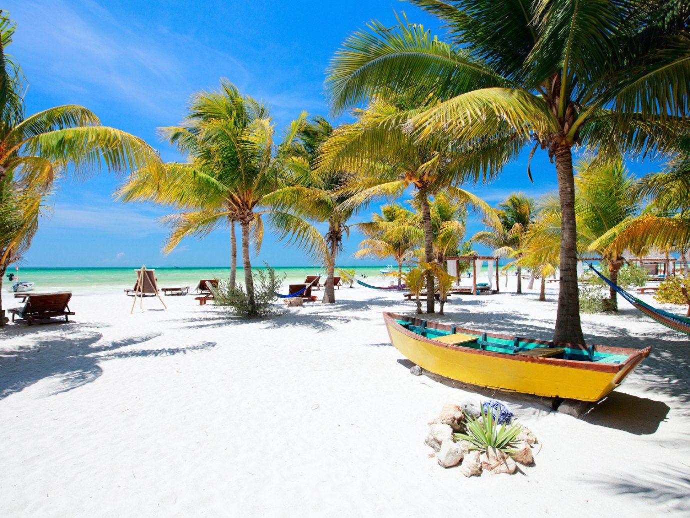 Secret Getaways Trip Ideas tree outdoor sky water Beach palm leisure Resort vacation caribbean arecales Sea Ocean Pool Lagoon tropics bay Island plant shore lined sandy