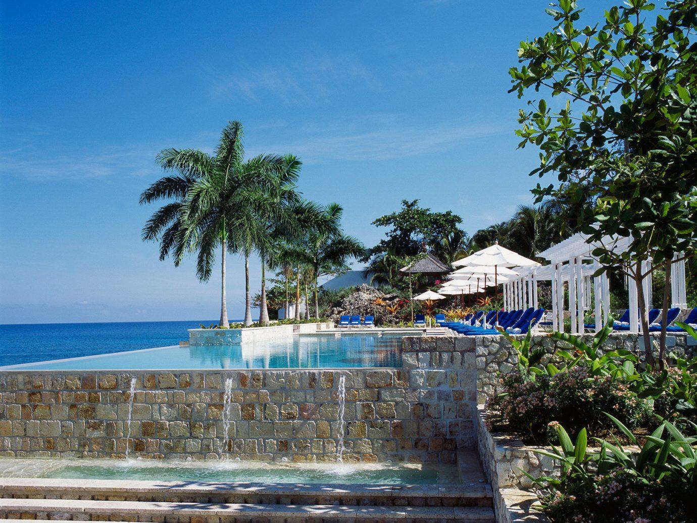 Hotels tree outdoor sky Beach wooden vacation Resort Sea park Ocean arecales estate walkway tropics Coast caribbean Garden stone