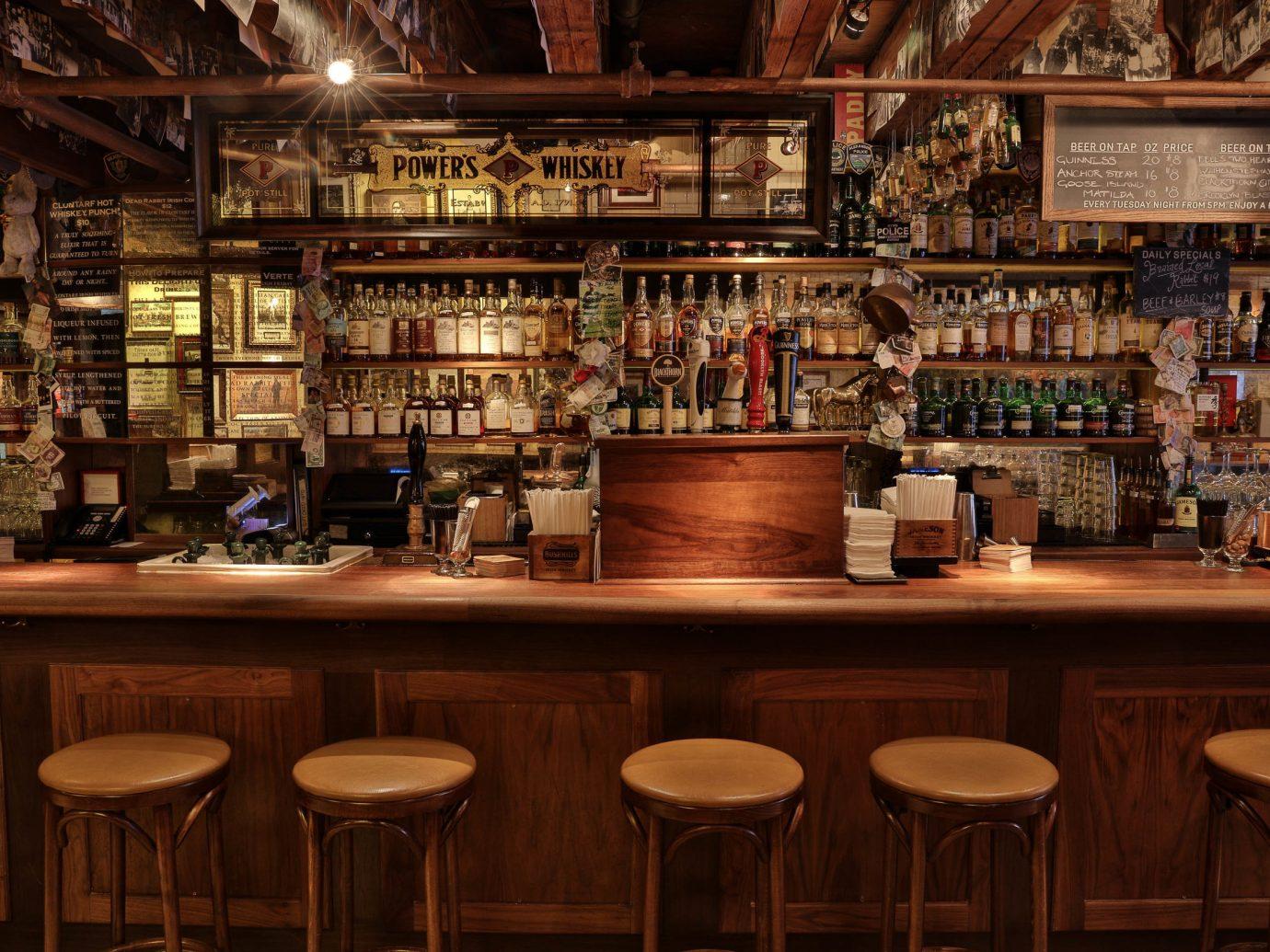 Food + Drink indoor Bar shelf tavern pub liquor store restaurant interior design café cluttered