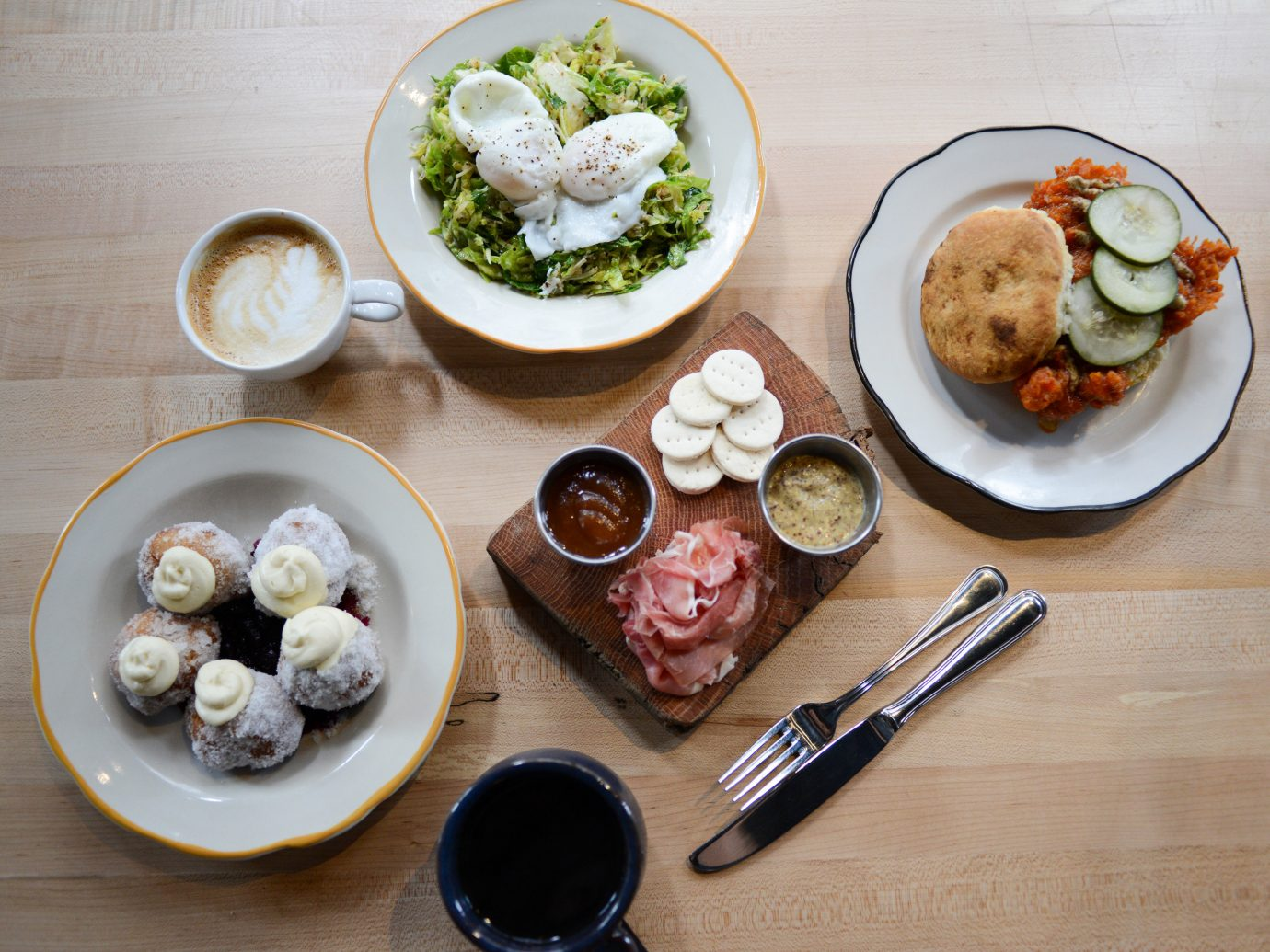 Food + Drink Trip Ideas Weekend Getaways table plate food dish meal breakfast lunch wooden cuisine produce sense brunch several