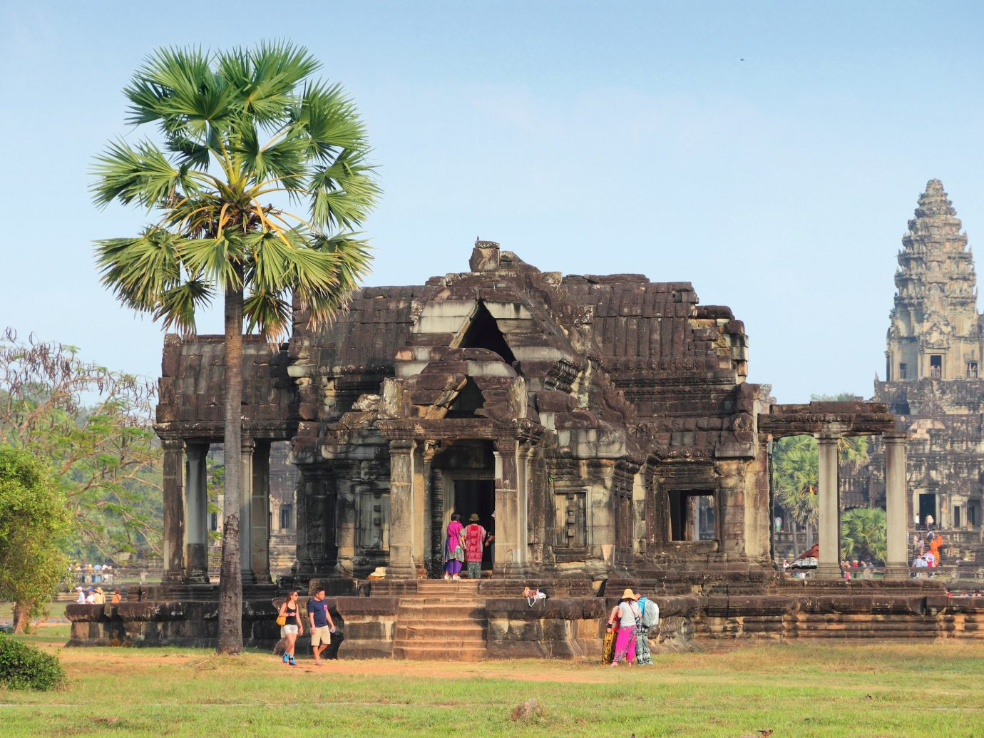 Arts + Culture Landmarks Trip Ideas outdoor grass sky building hindu temple historic site archaeological site ancient history tree arecales temple place of worship palm tree Ruins old stone