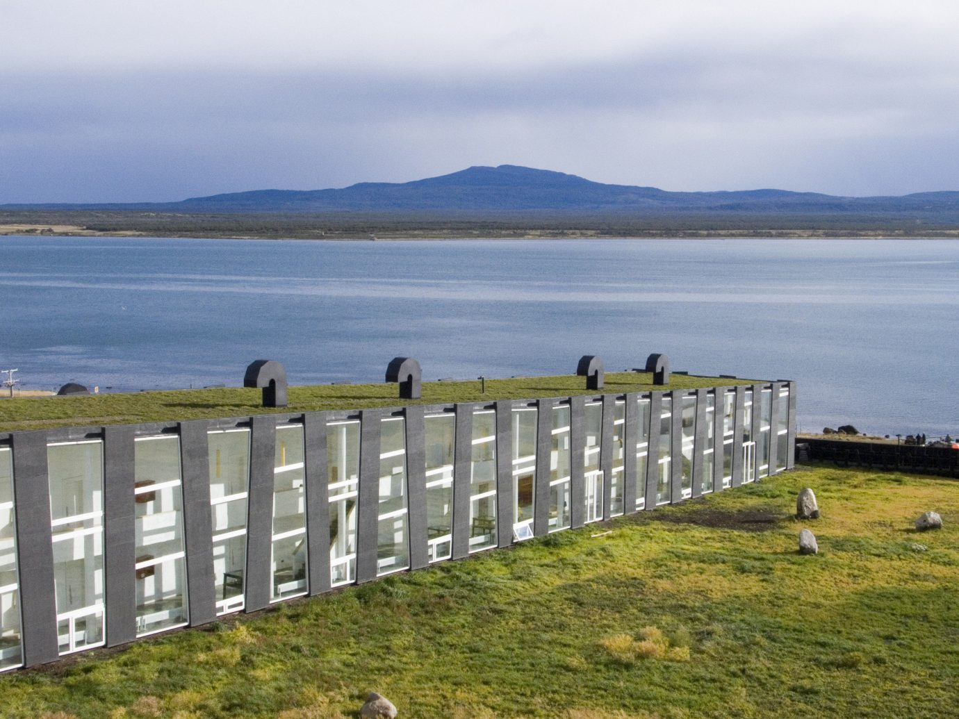 Hotels grass sky water outdoor shore Coast body of water overlooking Sea Lake loch reservoir bay flock pasture lush