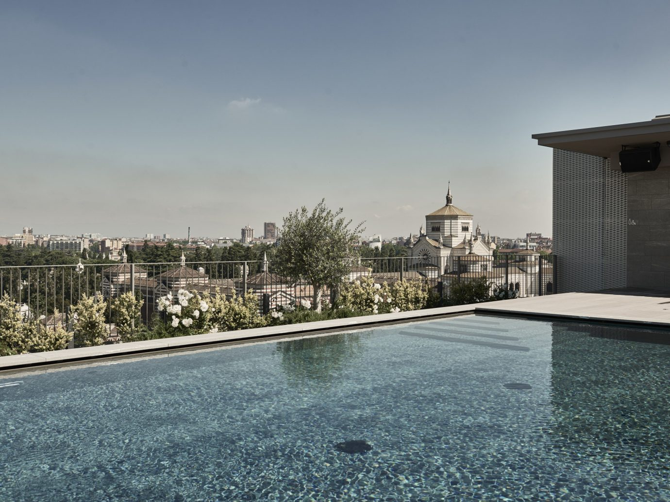 Hotels Italy Milan outdoor sky road water Architecture estate building residential area roof real estate City home tree condominium house window reflecting pool