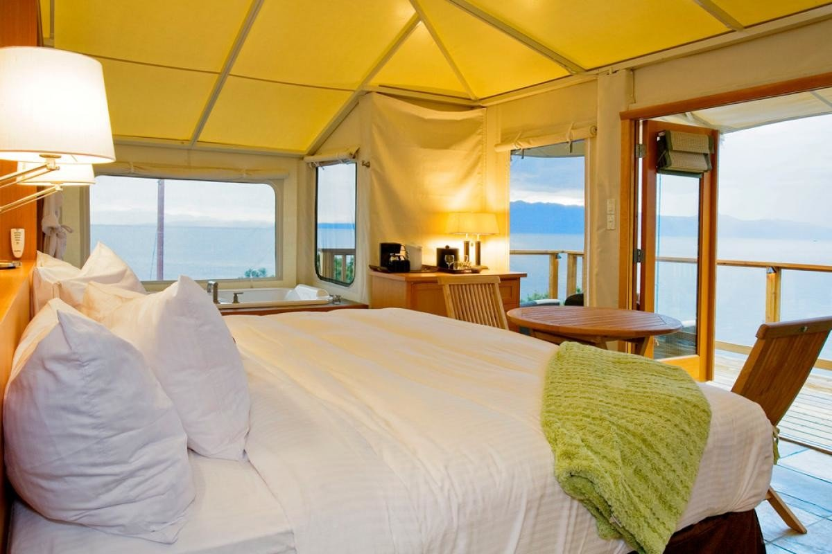 Glamping Outdoors + Adventure Trip Ideas bed indoor wall hotel room property Bedroom window Resort ceiling vacation Suite estate cottage Villa real estate apartment