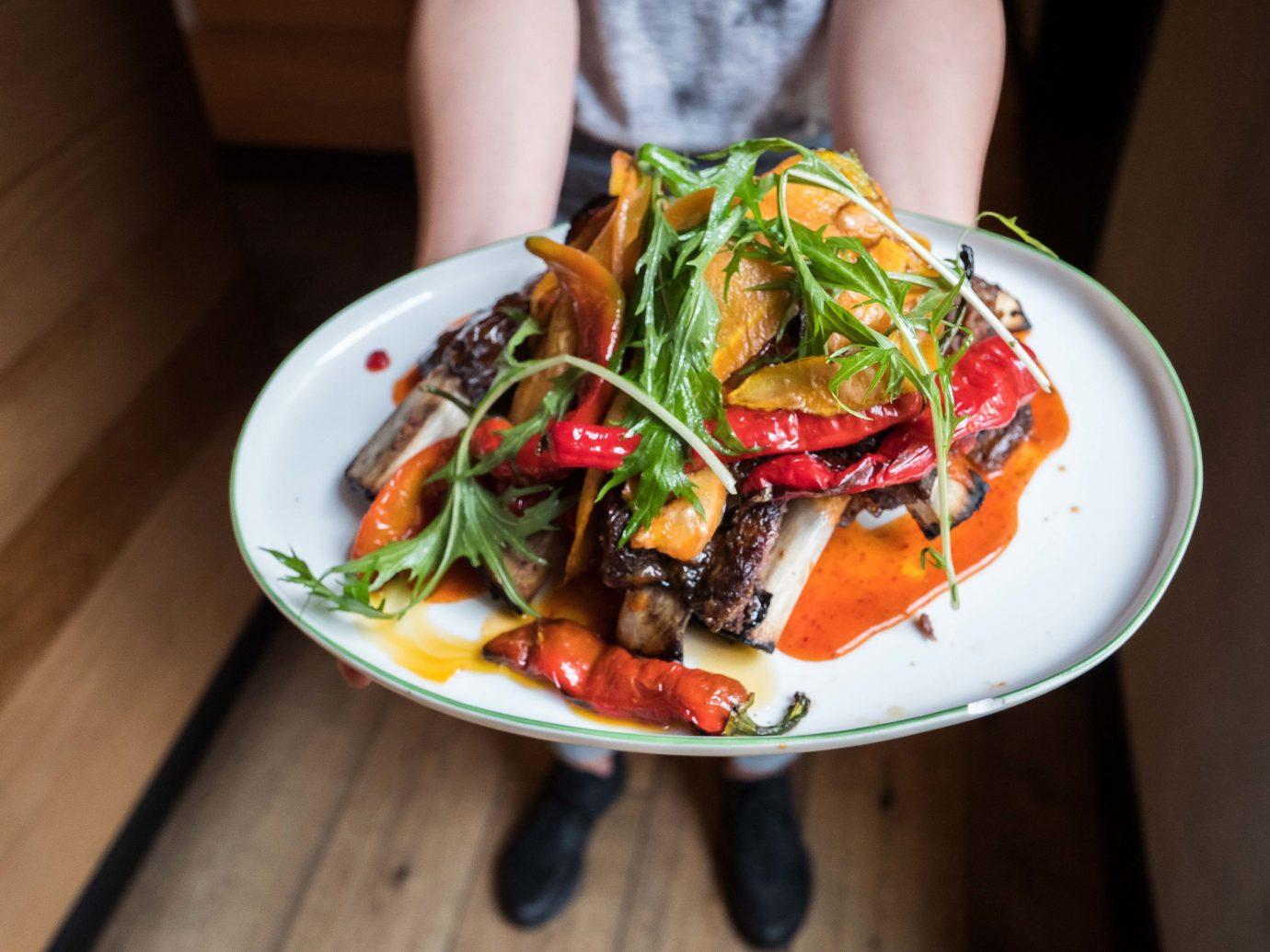 Food + Drink Travel Tips person food plate dish indoor salad vegetarian food cuisine vegetable Seafood meal thai food asian food recipe