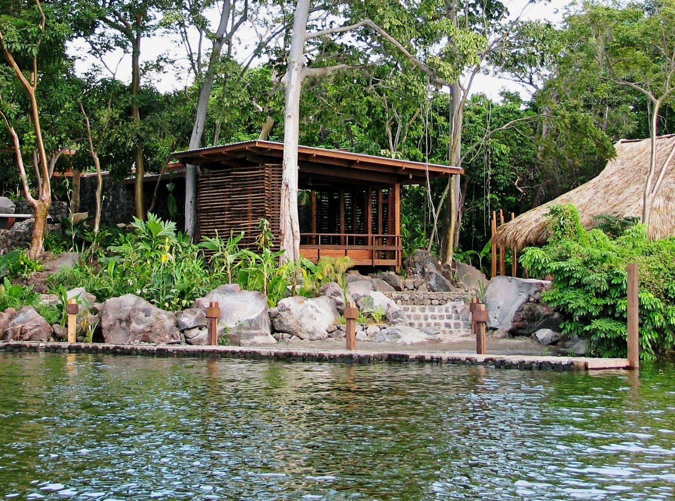 Hotels Outdoors + Adventure tree outdoor Resort rock pond Jungle Nature zoo backyard Garden Village swimming pool stone several