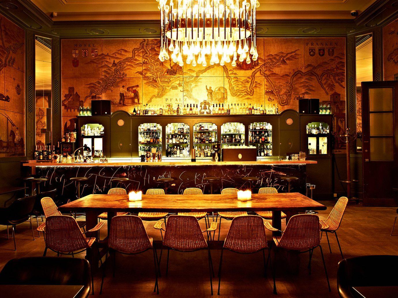 ambient lighting artistic artsy Bar bar seating charming cozy dark dim Hip homey interior trendy Trip Ideas warm yellow indoor floor ceiling restaurant meal dining room