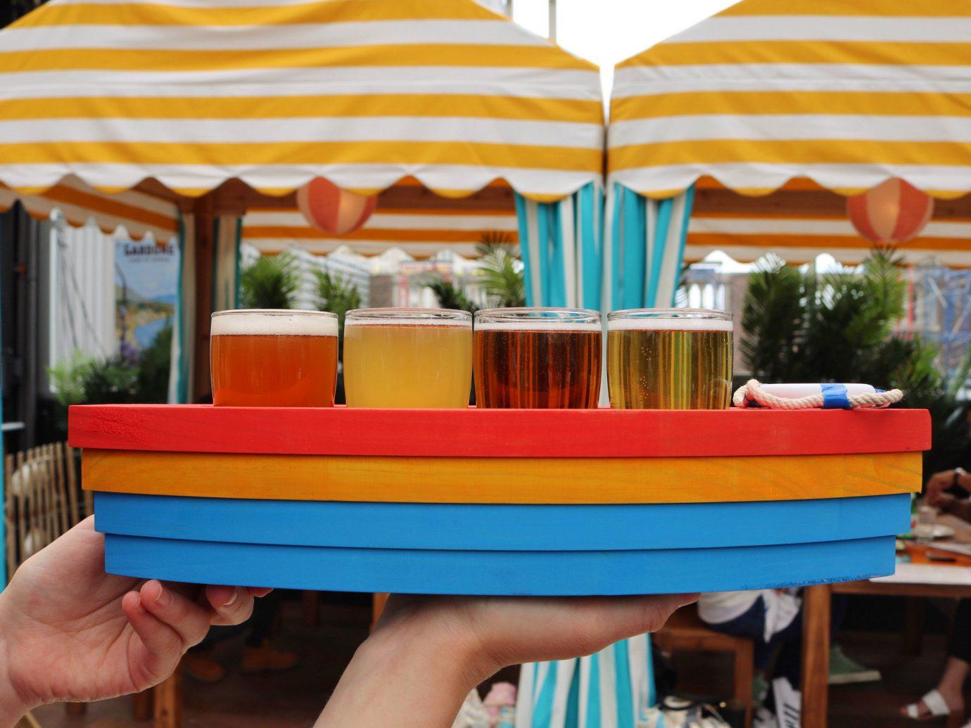 beer beer garden beer tasting Boat Drink flight Food + Drink Patio Terrace person leisure amusement park Play vacation colorful amusement ride Resort furniture blue