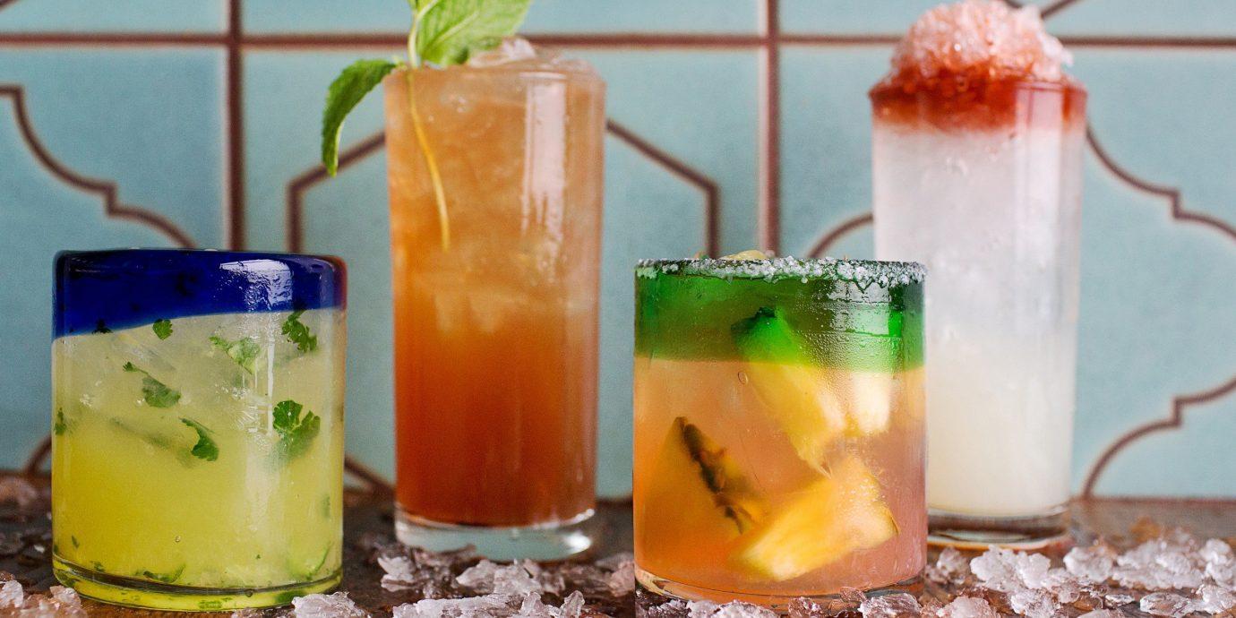 Food + Drink cup food Drink cocktail alcoholic beverage non alcoholic beverage beverage mai tai produce juice slice blender fresh fruit drink
