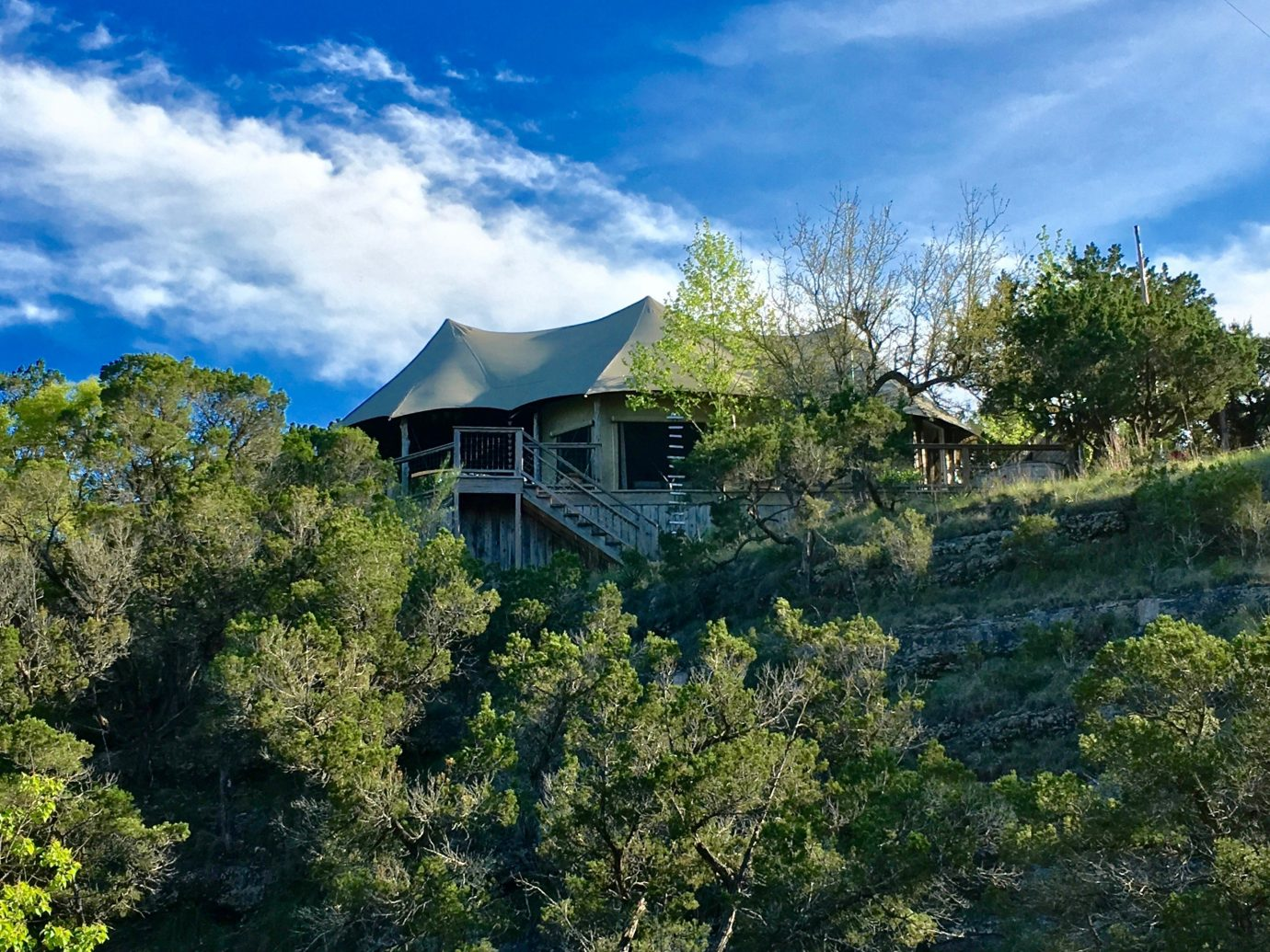 Glamping Outdoors + Adventure Trip Ideas tree outdoor sky Nature mountainous landforms wilderness mountain estate hill Forest mountain range rural area landscape plant bushes surrounded lush