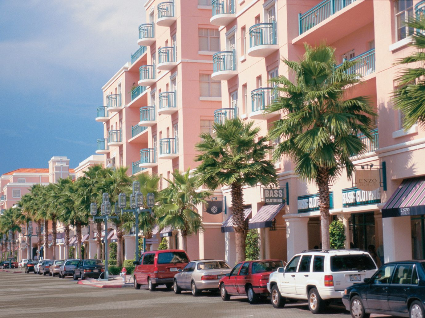 palm trees shopping streets Trip Ideas outdoor road condominium property neighbourhood Town residential area City building Downtown human settlement plaza street tower block facade apartment